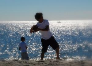 Boy throwing ball by Kasia